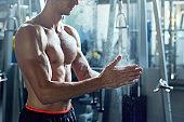 Handsome Man Ready to Weightlift in Gym