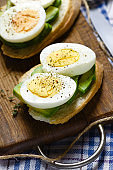 Healthy breakfast. Sandwich with avocado and boiled eggs