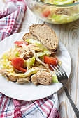 Salad with chicken and tomatoes in white plate