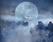 Full moon on scary mountain peaks at night