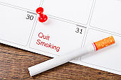 Push pins marked date Quit Smoking on calendar 31th May