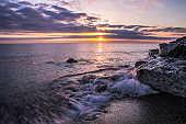 Waves Crash On A Rocky Michigan Great Lakes Beach At Sunrise