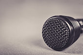 Microphone on fabric background with copy space close up