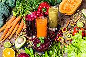Healthy vegan food. Fresh vegetables on wooden background. Detox diet. Different colorful fresh juices