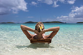 Woman relaxing in tropical water in the Caribbean
