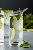 Fresh cold detox non-alcoholic cocktails for healthy eating on gray table.