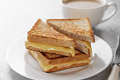 Grilled cheese sandwich of wholegrain bread with coffee for healthy breakfast.