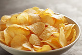 Big bowl of potato chips with crab taste on the table.