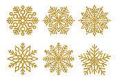 Set of glitter golden Snowflakes. Winter elements. Shining snowflakes on white background