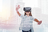 Smiling girl in VR headset against urban background