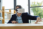 Pleasant smart man being in a virtual reality