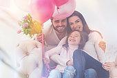 Adorable charming emotional family having a celebration