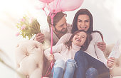 Adorable girl and her parents enjoying little family party