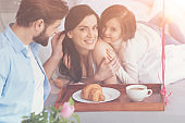 Attractive thankful woman happy having a family like this