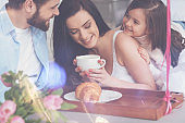 Optimistic excited young family experiencing a great morning
