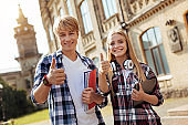 Optimistic young students having great time at the campus