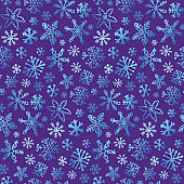 Hand drawn doodle winter snowflakes. Winter pattern