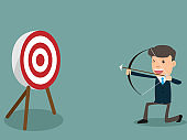 Determined handsome businessman aiming at target with bow and arrow. business target and success concept vector illustration.
