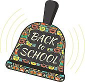 Back to school ringing bell symbol with school pattern cover