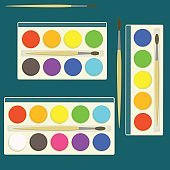 Set of bright flat vector watercolor paints in box for drawing lessons with different colors palette