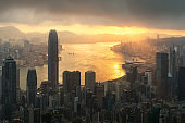 Sunrise over Hong Kong Victoria Harbor from Victoria Peak with Hong Kong and Kowloon below.