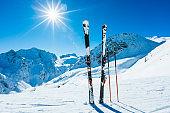 Skis and ski poles on remote slope