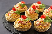 Festive appetizer vol-au-vent with chicken salad, sweet pepper, corn