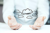 Man working with touch screen- clouds