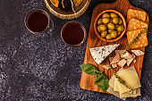 Cheese cracker olives wine.