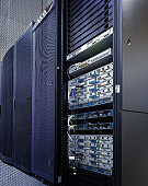 stand with supercomputers of the modern data center with the door open and entrails
