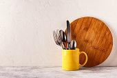 Crockery and cutlery on a light table.