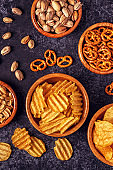 Snacks in a bowls on stone background.