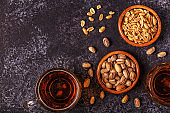 Beer and nuts on stone background.