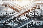 Multiple escalators inside of Porto airport terminal