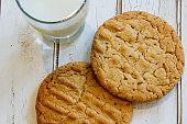 Close up of fresh peanut butter cookies and milk