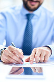 Financial advisor examining report