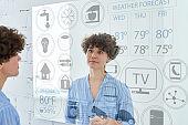 Woman using smart mirror