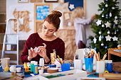 Talented craftswoman making Christmas toy
