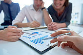 Successful Business Team Analyzing Financial Data in Office