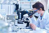 Biologist researching dangerous substance