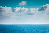 Sea and sky with clouds blue background with empty space.