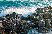 Waves on rocky sea shore.