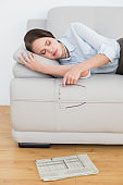 Well dressed woman sleeping on sofa