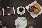 High angle view of muffins with coffee on table