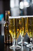 Glasses of beer ready to serve on bar counter
