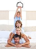 Jolly family having fun with black house illustration