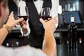 Bartender serving glasses of wine