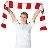 Pretty football fan in white cheering