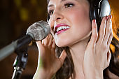 Woman singing in bar