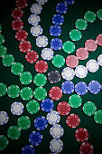 Casino chips arranged on poker table